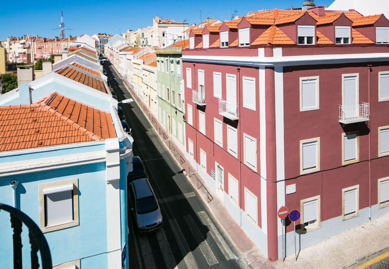Vue de l'immeuble sur le quartier de Graça pour des vacances entre amis