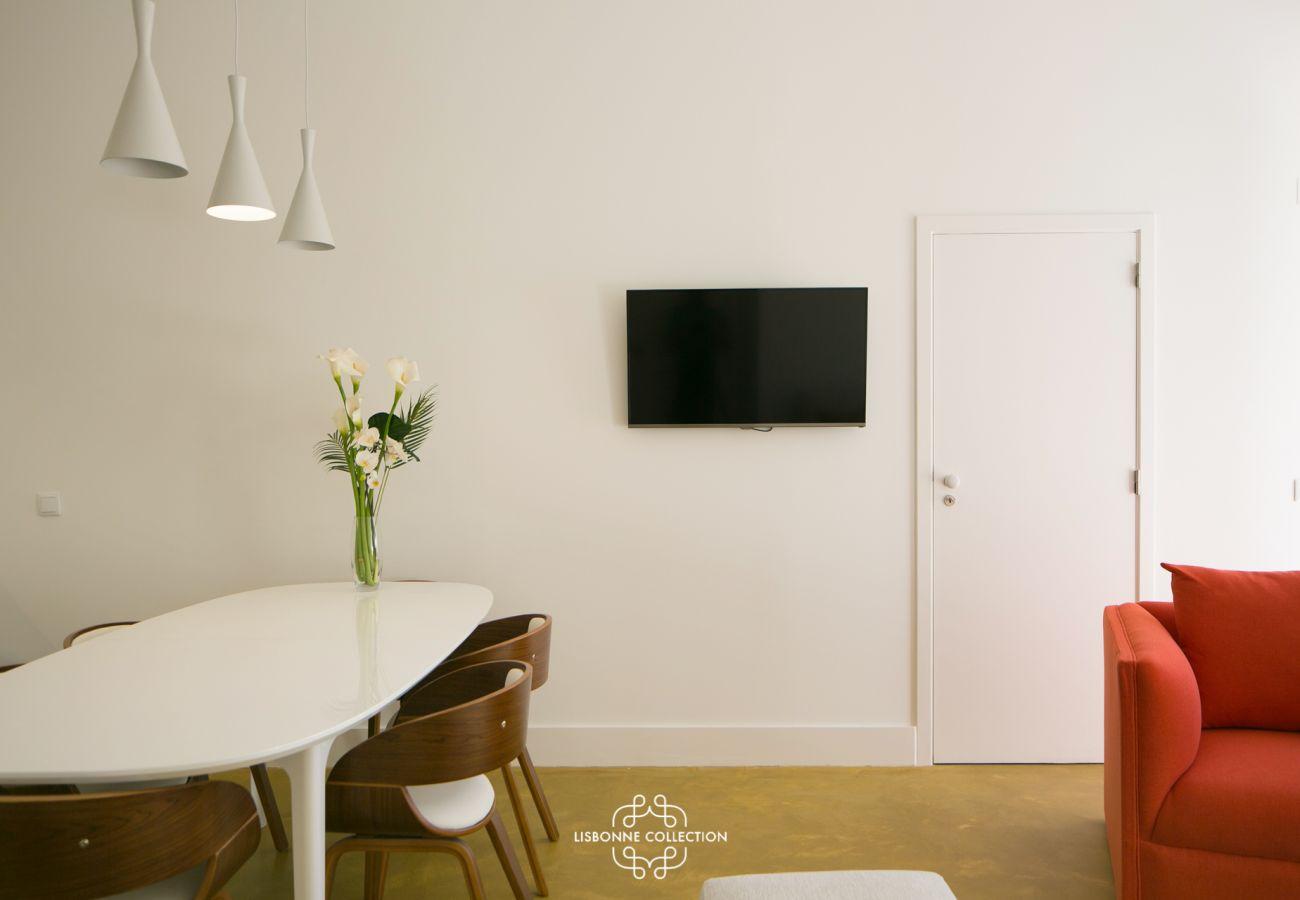 Salon salle à manger dans un appartement de location dans le quartier de Graça