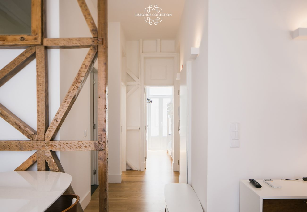 Couloir de l'entrée donnant sur les chambres et sur la cuisine américaine