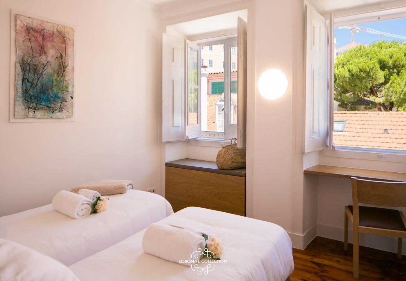 chambre avec vue sur les collines de Lisbonne